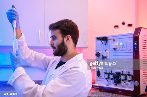 Bruno Cassaro de Andrade, a chemical engineering student, works with a test during the method of separating specific proteins to be applied in the...