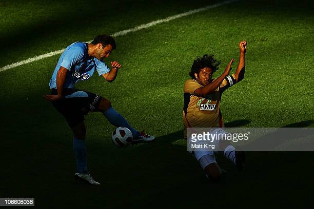 Bruno Cazarine of Sydney takes a shot on goal as Nikolai ToporStanley of the Jets defences during the round 13 ALeague match between Sydney FC and...