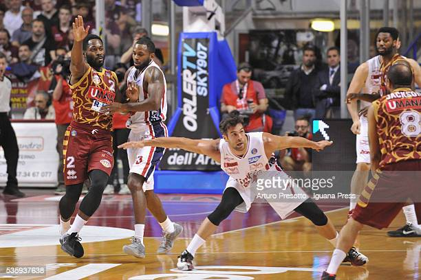 Bruno Cerella of EA7 competes with Jeremy Pargo and Jarrius Jackson of Umana duriing the LegaBsaket Serie A match between Reyer Umana Venezia and EA7...