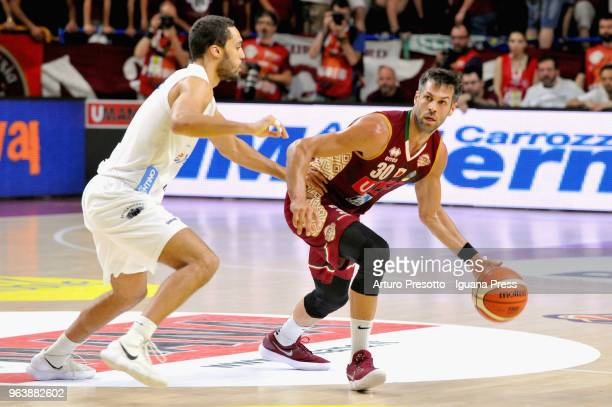 Bruno Cerella of Umana competes with Yannick Franke of Dolomiti Energia during the LBA Legabasket of Serie A match play off semifinal game 1 between...