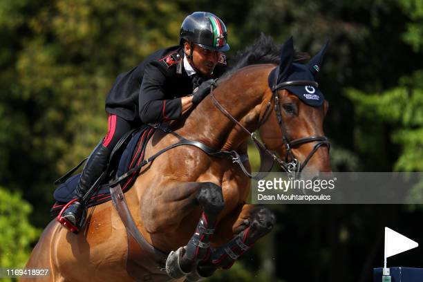 Bruno Chimirri of Italy riding Tower Mouche competes during Day 3 of the Longines FEI Jumping European Championship speed competition against the...