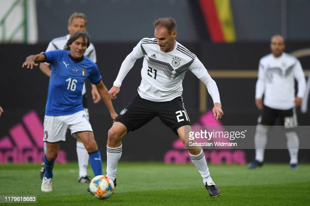 Bruno Conti of Azzurri Legends and Alexander Zickler of DFBAllStars compete for the ball during the Friendly Match between the DFBAllStars and...