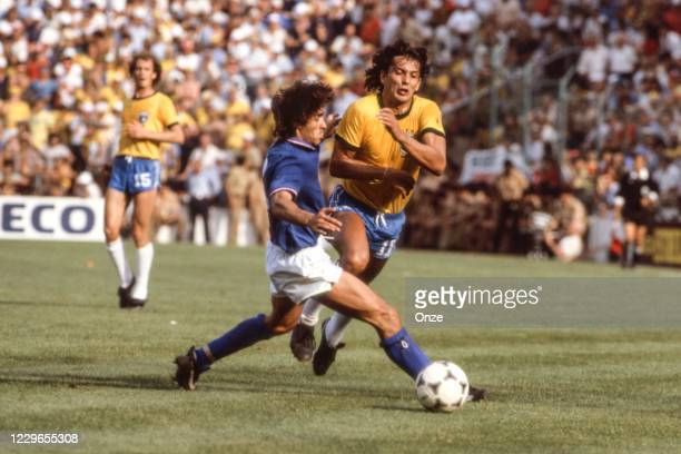 Bruno Conti of Italy and Eder of Brazil during the second stage of the 1982 FIFA World Cup match between Italy and Brazil, at Sarria Stadium,...