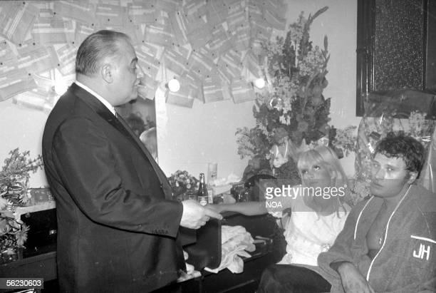 Bruno Coquatrix Sylvie Vartan and Johnny Hallyday in the dressing room of Johnny Hallyday Paris Olympia HA10223