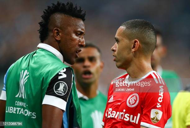 Bruno Cortez of Gremio and Marcos Guilherme of Internacional argue during the match for the Copa CONMEBOL Libertadores 2020 at Arena do Gremio on...