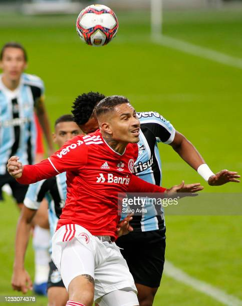 Bruno Cortez of Gremio and Paolo Guerrero of Internacional fight for the ball during the final of Rio Grande Do Sul State Championship 2021 between...