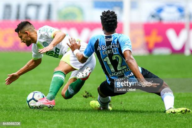 Bruno Cortez of Gremio battles for the ball against Alan Ruschel of Chapecoense during the match Gremio v Chapecoense as part of Brasileirao Series A...