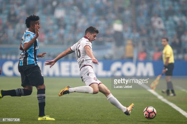 NOVEMBER 22 Bruno Cortez of Gremio battles for the ball against Alejandro Silva of Lanus during the match between Gremio and Lanus part of Copa...