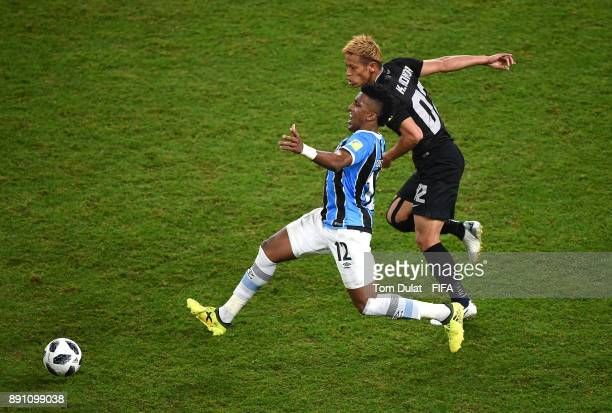 Bruno Cortez of Gremio FBPA and Keisuke Honda of CF Pachuca battle for the ball during the FIFA Club World Cup UAE 2017 match between Gremio FBPA and...
