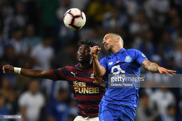 Bruno Costa of FC Porto competes for the ball with Christian Atsu of Newcastle during the preseason friendly match between FC Porto and Newcastle at...