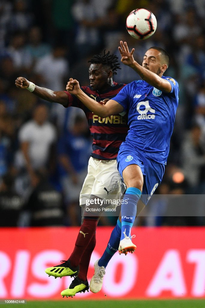 Bruno Costa of FC Porto competes for the ball with Christian Atsu of Newcastle during the pre-season friendly match between FC Porto and Newcastle at Estádio do Drago on July 28, 2018 in Porto, Portugal.