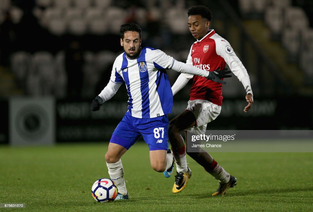 Bruno Costa of Porto takes the ball away from Joseph Willock of Arsenal during the Premier League International Cup match between Arsenal and Porto at Meadow Park on November 17, 2017 in Borehamwood, England.