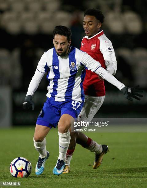 Bruno Costa of Porto takes the ball away from Joseph Willock of Arsenal during the Premier League International Cup match between Arsenal and Porto...