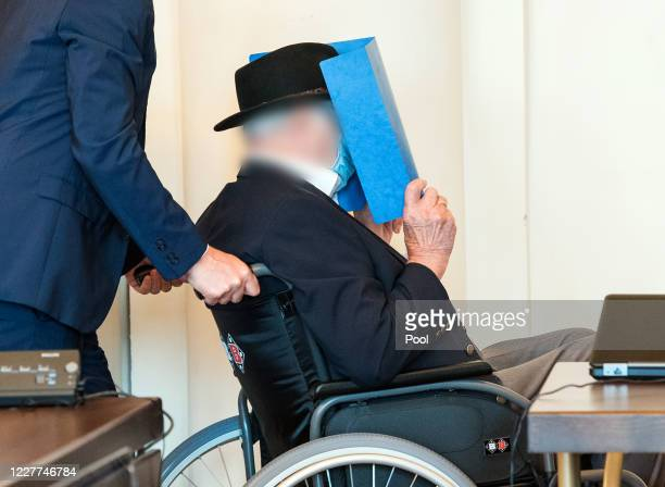 Bruno Dey, 93-year-old former SS security guard from the Stutthof concentration camp near Gdansk sits in a courtroom behind a plexiglass window in...
