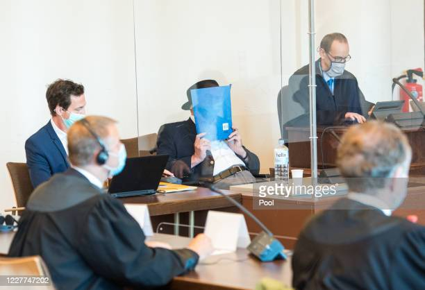 Bruno Dey 93yearold former SS security guard from the Stutthof concentration camp near Gdansk sits in a courtroom behind a plexiglass window next to...