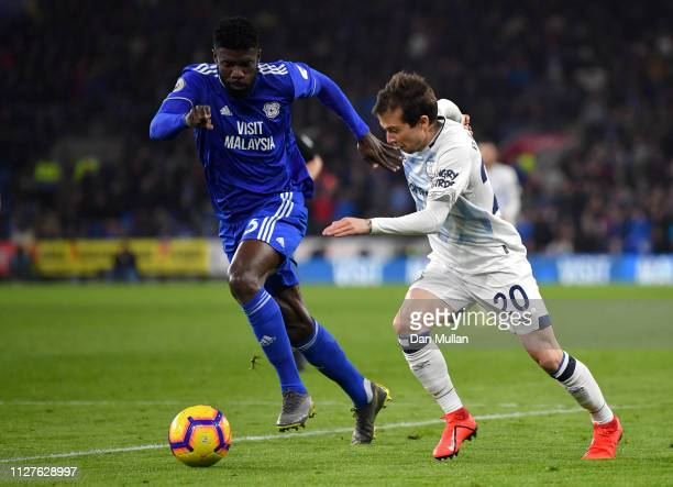 Bruno Ecuele Manga of Cardiff City and Bernard of Everton chase the ball during the Premier League match between Cardiff City and Everton FC at...