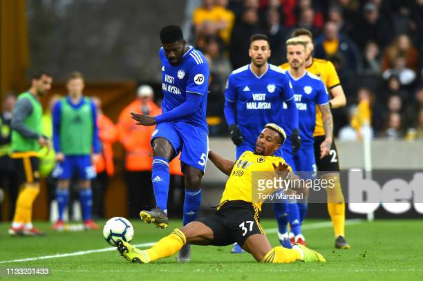 Bruno Ecuele Manga of Cardiff City is challenged by Adama Traore of Wolverhampton Wanderers during the Premier League match between Wolverhampton...