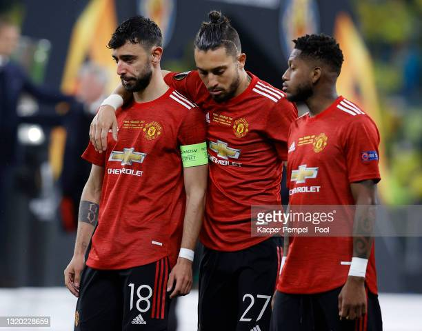 Bruno Fernandes, Alex Telles and Fred of Manchester United look dejected following the UEFA Europa League Final between Villarreal CF and Manchester...
