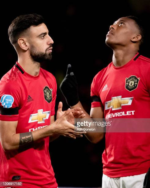 Bruno Fernandes and Anthony Martial of Manchester United line up ahead of the Premier League match between Chelsea FC and Manchester United at...