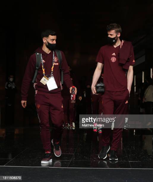 Bruno Fernandes and David de Gea of Manchester United leave the team hotel ahead of the UEFA Europa League Quarter Final First Leg match between...