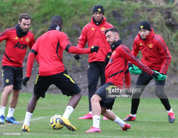 Bruno Fernandes and Eric Bailly of Manchester United in action during a first team training session at Aon Training Complex on January 31 2020 in...