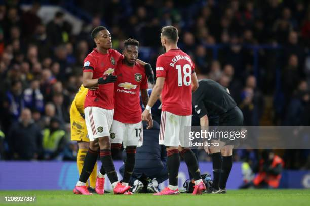 Bruno Fernandes and Fred of Manchester United congratulate teammate Anthony Martial after he scores a goal to make it 10 during the Premier League...
