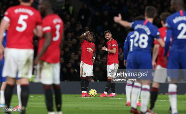 Bruno Fernandes and Fred of Manchester United discuss a free kick during the Premier League match between Chelsea FC and Manchester United at...