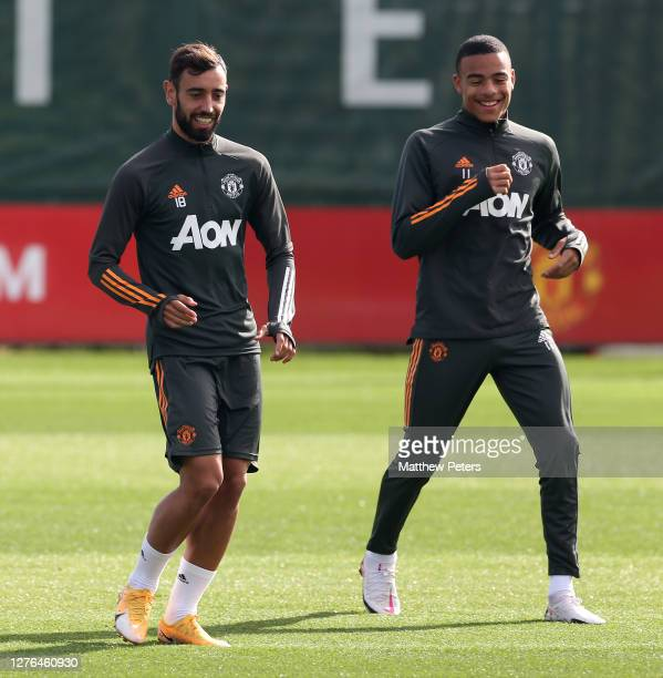 Bruno Fernandes and Mason Greenwood of Manchester United in action during a first team training session at Aon Training Complex on September 24 2020...