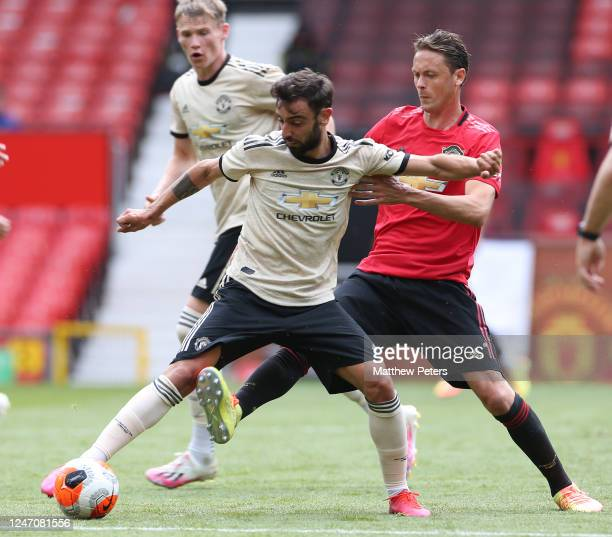 Bruno Fernandes and Nemanja Matic of Manchester United in action during a first team training session at Old Trafford on June 06, 2020 in Manchester,...