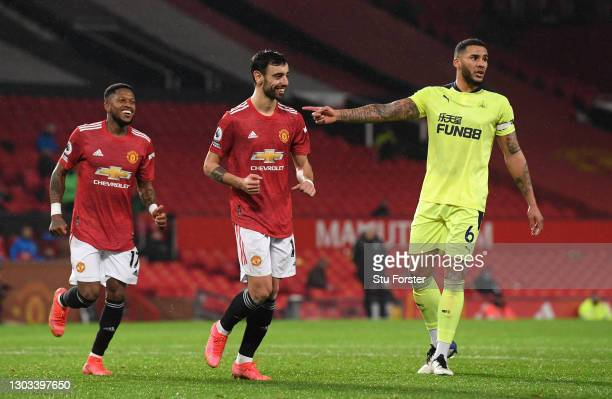 Bruno Fernandes celebrates with Fred of Manchester United after scoring from the penalty spot as Jamaal Lascelles of Newcastle reacts during the...