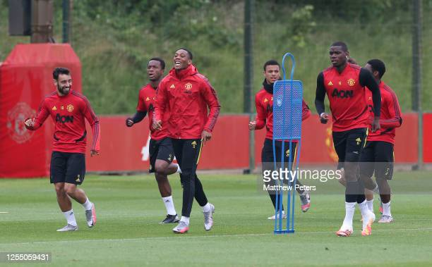 Bruno Fernandes Ethan Laird Anthony Martial Mason Greenwood Paul Pogba of Manchester United in action during a first team training session at Aon...