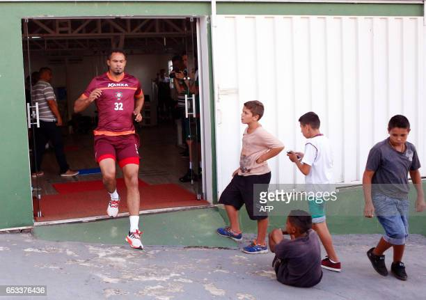 Bruno Fernandes former goalkeeper of Atletico MG and Flamengo trains as he is observed by children during his presentation as the new BOA Esporte...