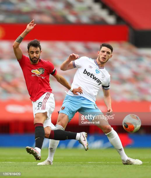 Bruno Fernandes of Manchester United and Declan Rice of West Ham United battle for the ball during the Premier League match between Manchester United...