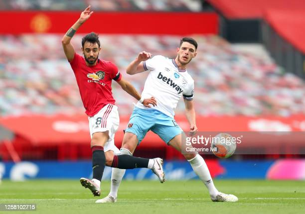 Bruno Fernandes of Manchester United and Declan Rice of West Ham United compete during the Premier League match between Manchester United and West...