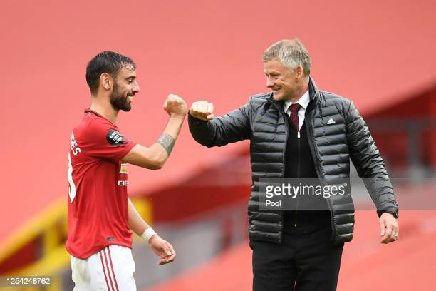 Bruno Fernandes of Manchester United and Ole Gunnar Solskjaer, Manager of Manchester United elbow bump following the Premier League match between...