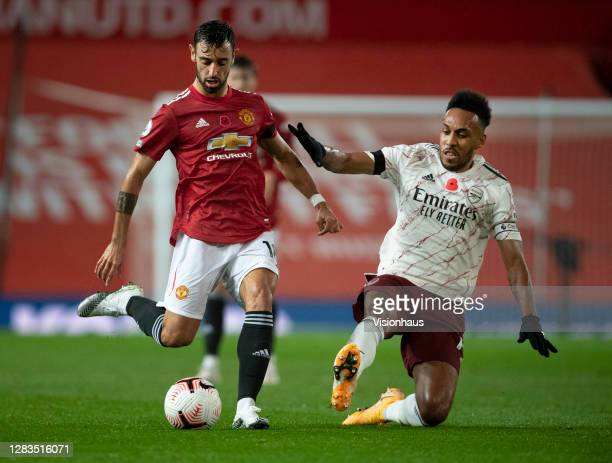 Bruno Fernandes of Manchester United and Pierre-Emerick Aubameyang of Arsenal in action during the Premier League match between Manchester United and...