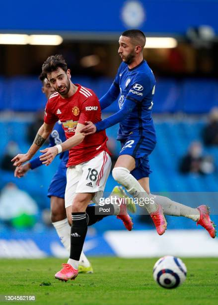 Bruno Fernandes of Manchester United battles for possession with Hakim Ziyech of Chelsea during the Premier League match between Chelsea and...