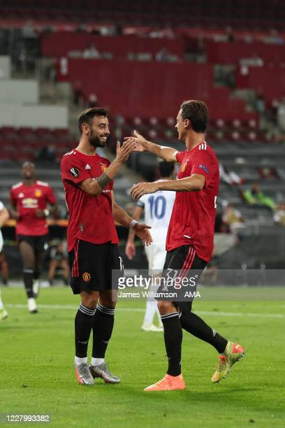 Bruno Fernandes of Manchester United celebrates after scoring a goal to make it 1-0 from a penalty with Nemanja Matic during the UEFA Europa League...