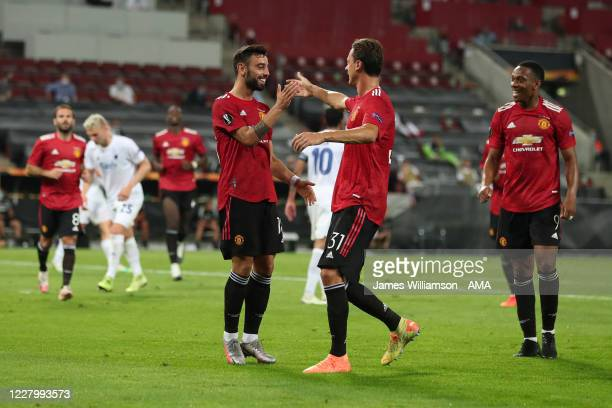 Bruno Fernandes of Manchester United celebrates after scoring a goal to make it 10 from a penalty during the UEFA Europa League Quarter Final between...