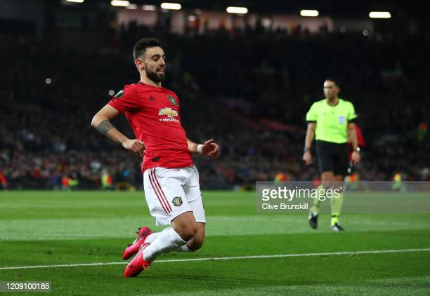 Bruno Fernandes of Manchester United celebrates after scoring his team's first goal from the penalty spot during the UEFA Europa League round of 32...