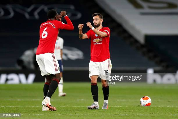 Bruno Fernandes of Manchester United celebrates after scoring his sides first goal with teammate Paul Pogba of Manchester United during the Premier...