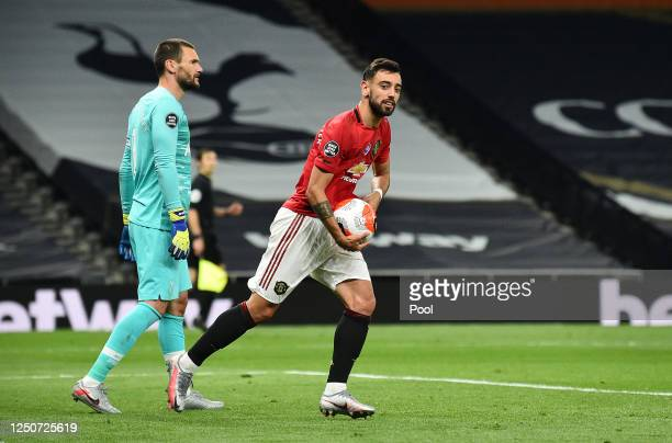 Bruno Fernandes of Manchester United celebrates after scoring his team's first goal from the penalty spot during the Premier League match between...