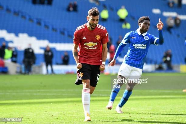Bruno Fernandes of Manchester United celebrates after scoring his sides third goal during the Premier League match between Brighton & Hove Albion and...