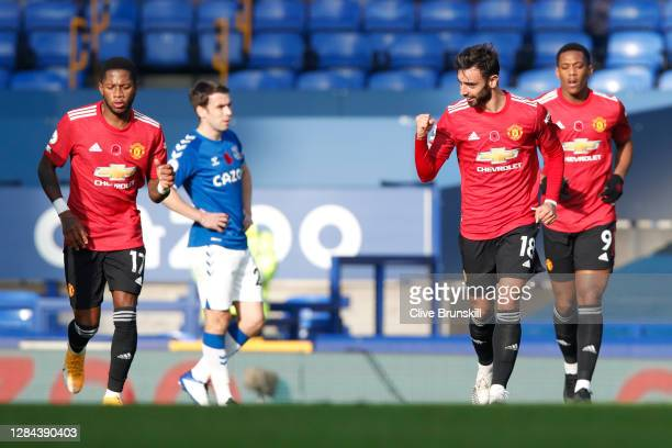 Bruno Fernandes of Manchester United celebrates after scoring his team's first goal during the Premier League match between Everton and Manchester...