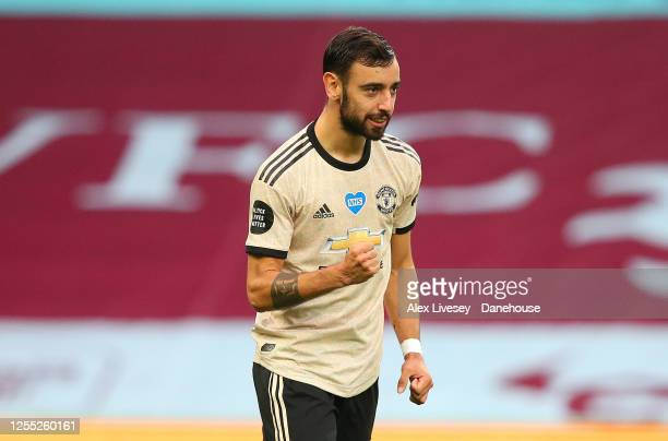 Bruno Fernandes of Manchester United celebrates after scoring the opening goal from a penalty kick during the Premier League match between Aston...