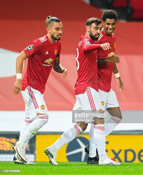 Bruno Fernandes of Manchester United celebrates after scoring their sides first goal with Alex Telles and Marcus Rashford during the UEFA Champions...