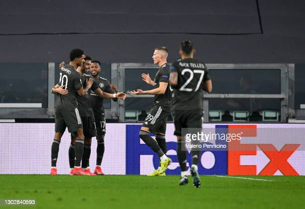 Bruno Fernandes of Manchester United celebrates after scoring their sides first goal with team mates Marcus Rashford, Fred and Scott McTominay of...