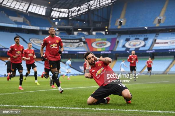 Bruno Fernandes of Manchester United celebrates after scoring their side's first goal from the penalty spot during the Premier League match between...