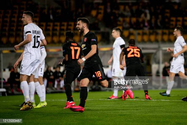 Bruno Fernandes of Manchester United celebrates Odion Ighalo scoring their first goal during the UEFA Europa League round of 16 first leg match...