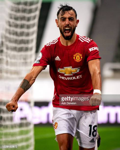 Bruno Fernandes of Manchester United celebrates scoring a goal to make the score 1-2 during the Premier League match between Newcastle United and...
